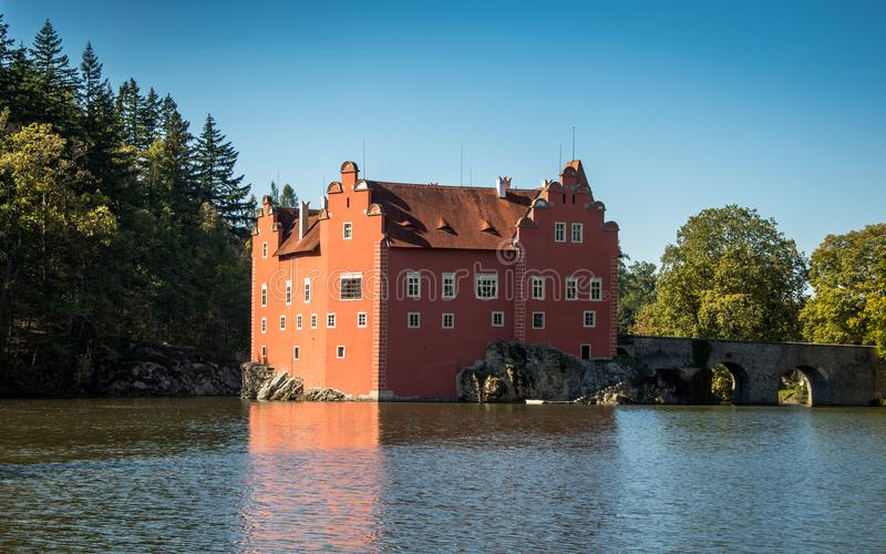 Cervena Lhota Castle from 14th century. It stands at the middle of a lake on a rocky island. The existence of an original fortress on the site of today`s châ royalty free stock images