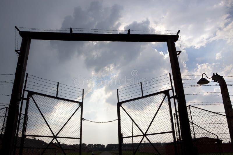 Exit door and barbed wire fence. Auschwitz camp