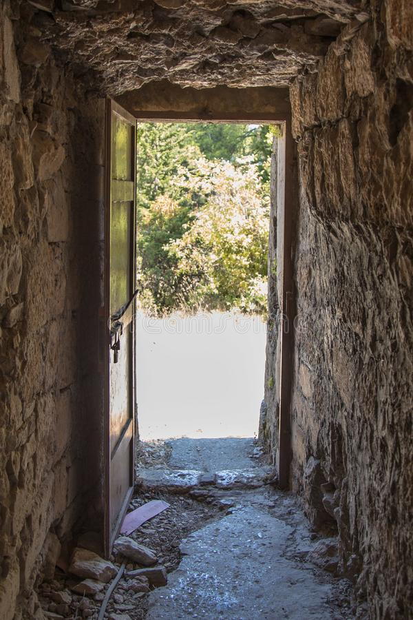 Mysterious exit from the castle. door exit tower royalty free stock images