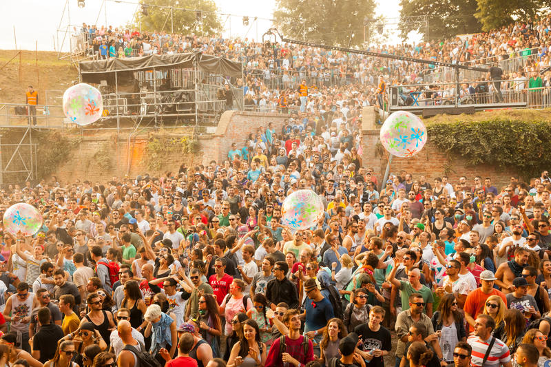 Exit Festival 2015 - Crowd in the sunrise on dj dance stage. NOVI SAD - JULY 12 : Crowd in the sunrise on Dj Arena dance stage at EXIT 2015 Music Festival July stock image