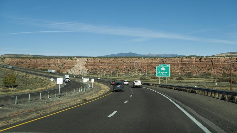 Laguna, NM exit on I-40 with divided highway and traffic royalty free stock photography