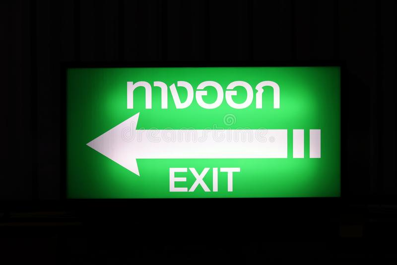 Exit Sign Box, Night Signage Box White arrow, green background Thai Word stock images