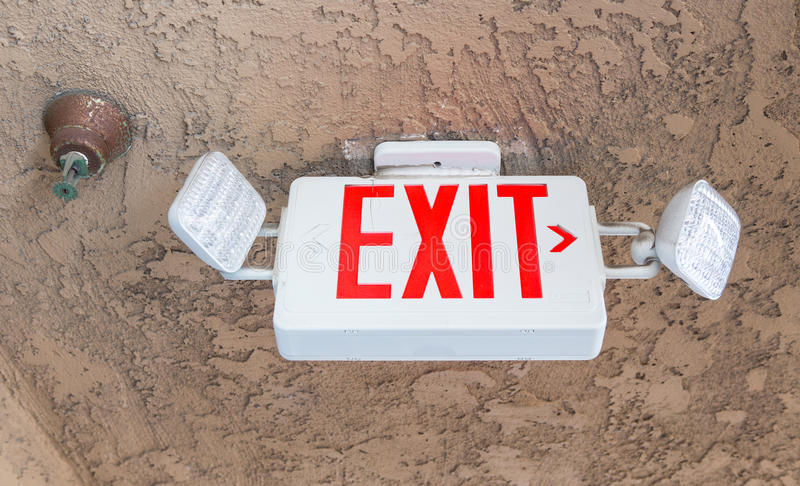 Exit sign with emergency light and fire extinguishing system stock images