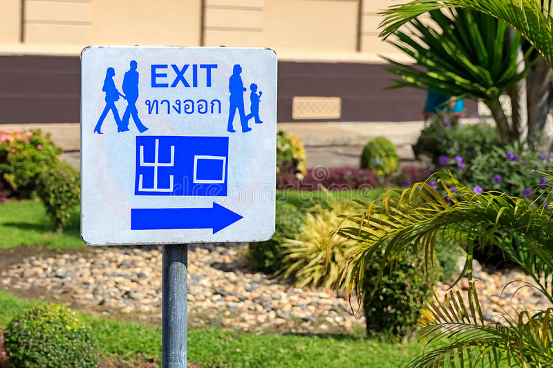 Exit Sign in English, Thai and Chinese Language royalty free stock images