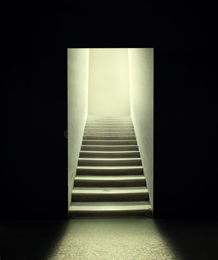 Only exit. Staircase inside a room in the dark royalty free stock image