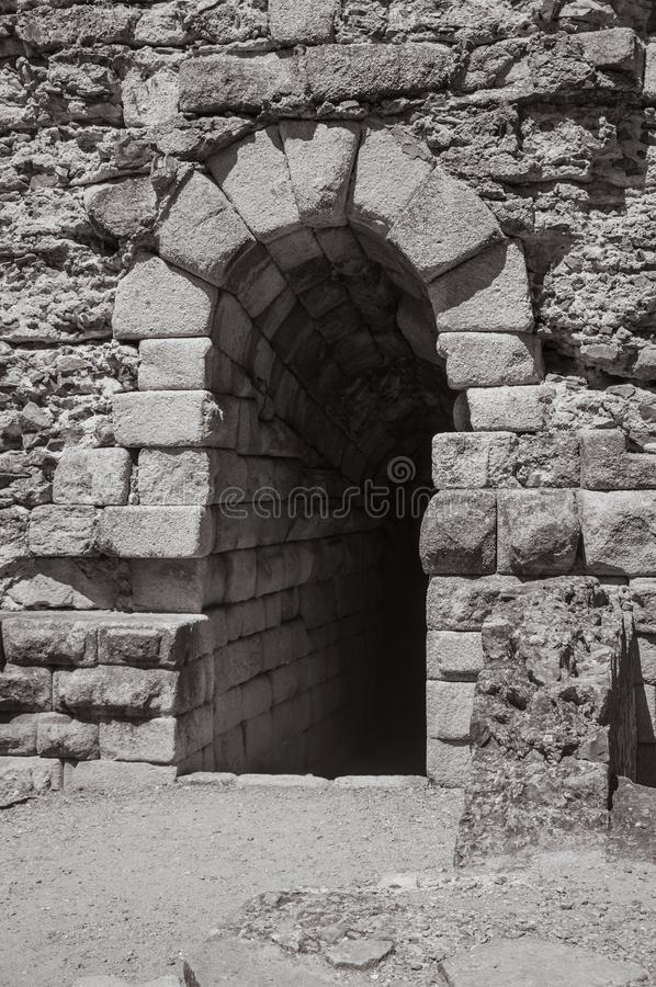 Exit on stone wall in the Roman Theater of Merida. Arched exit on stone wall in the Roman Theater, at the archaeological site of Merida. Founded by ancient Rome royalty free stock photo
