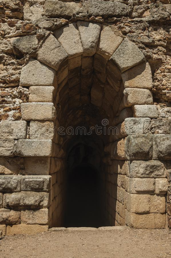 Exit on stone wall in the Roman Theater of Merida. Arched exit on stone wall in the Roman Theater in a sunny day, at the huge archaeological site of Merida stock photo