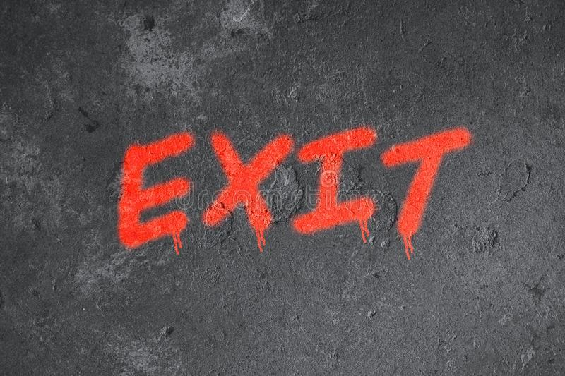 Exit text graffiti on grunge wall stock photos