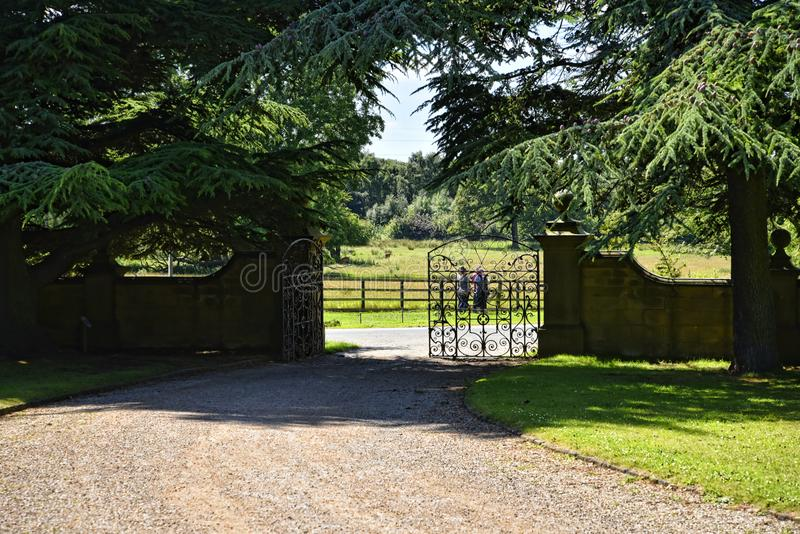 Exit to the deer park in Garden at Beautiful Country House near Leeds West Yorkshire that is not National Trust. Edwardian Country House that has been kept in stock photography