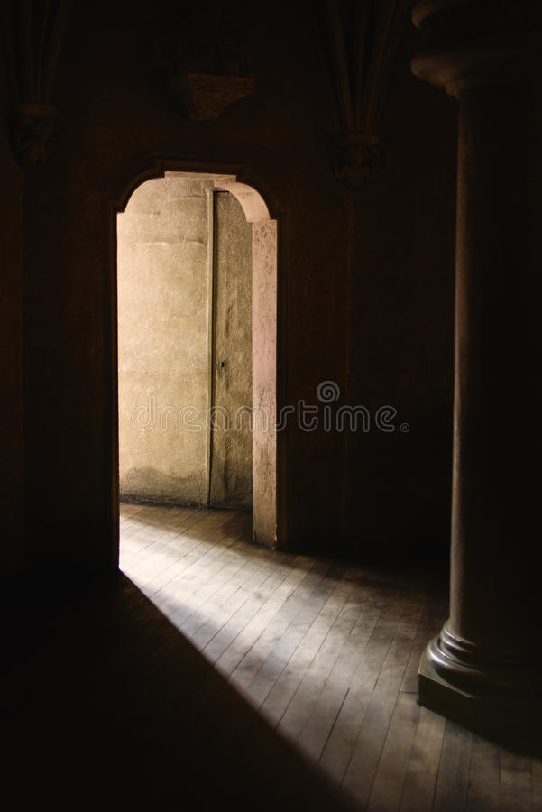 Exit To Light and New Beginning. Mystic Gothic Door with Sunlight Entering Dark Room, Exit to Light, Hope and New Beginning Concept, Vintage Retro Tone Effect stock images