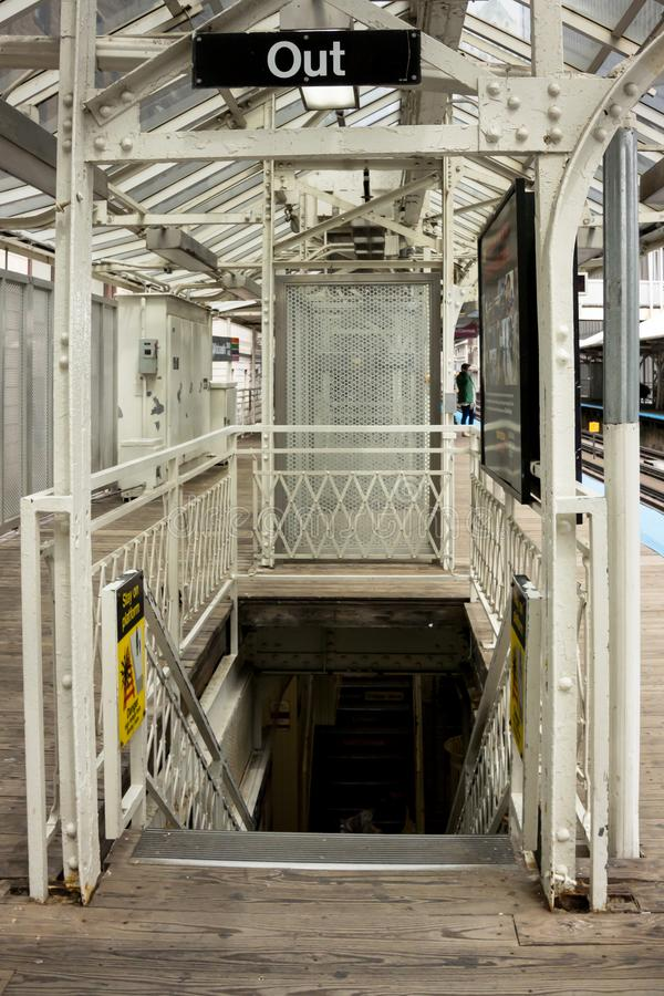 This Way Out. The exit on a wooden platform of an urban metro rail system royalty free stock photo
