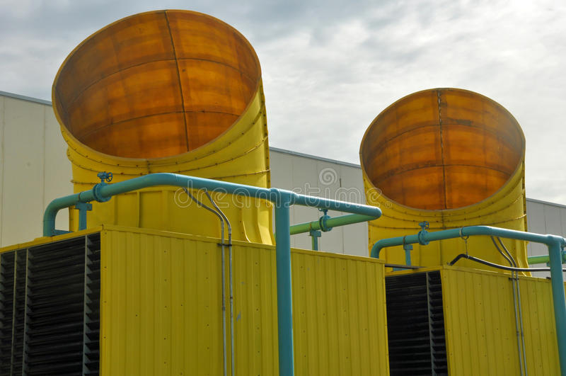 Exit of yellow ventilation pipes. Next to an industry stock photography