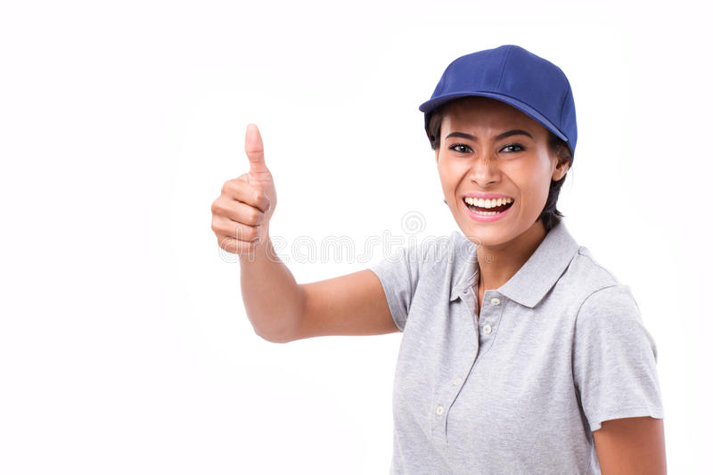 Exited female service staff showing thumb up. Hand gesture, white isolated background royalty free stock images