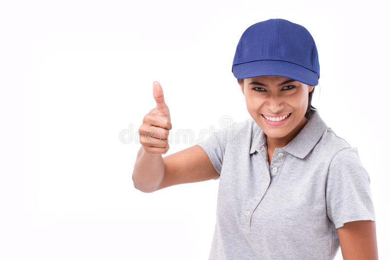 Exited female service staff showing thumb up hand gesture. White isolated background stock photo