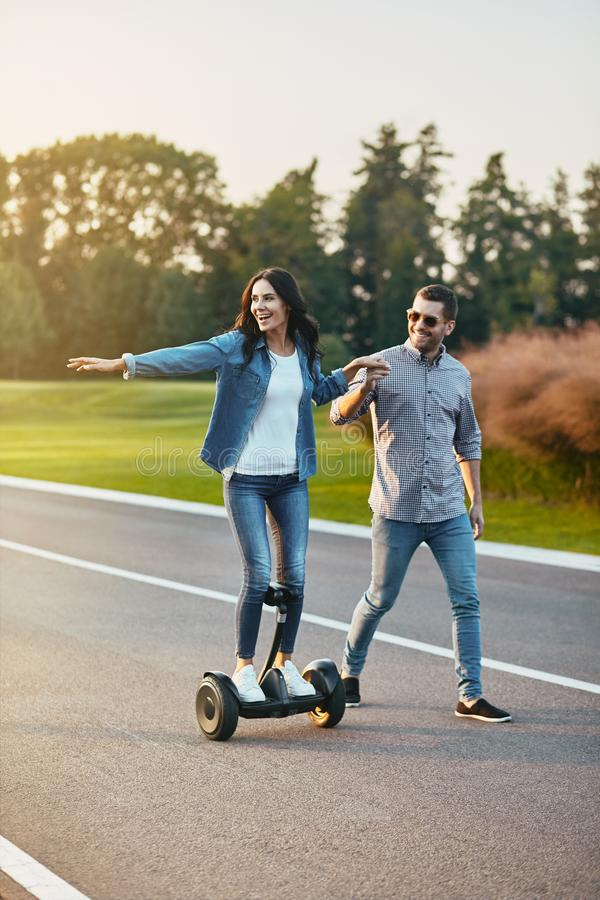 Woman riding electric hoverboard stock photos