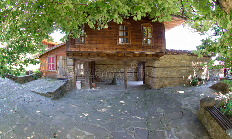 Exiting the church of St. Nicholas in the village of Zheravna stock photos