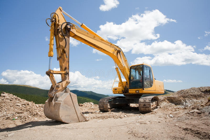 Exkavator, Gräber, Planierraupe an der Baustelle stockbilder