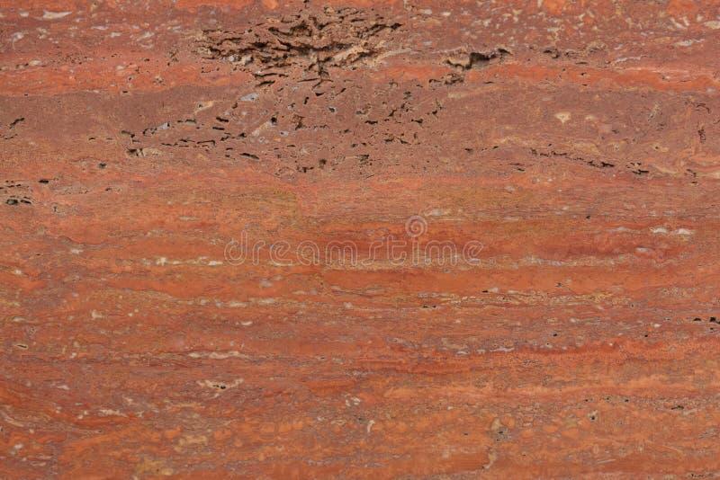 Exklusiver roter Travertinhintergrund für Ihren leistungsfähigen Innenraum lizenzfreie stockfotografie
