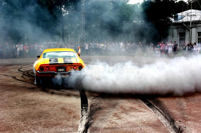 Exlusive car. Muscle car exclusive design cars exhibition rubber smoke royalty free stock image