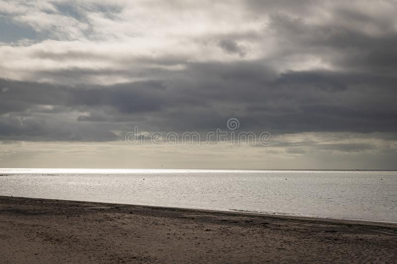 Exmouth Beach. On a summer morning with a still sea and warm light royalty free stock photo