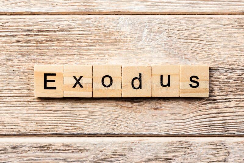 Exodus word written on wood block. exodus text on table, concept.  stock photography