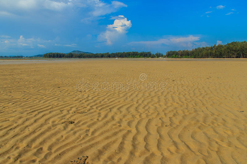 Exotic and beautiful wave pattern on the sand in the beach after. Sea water receded royalty free stock photography
