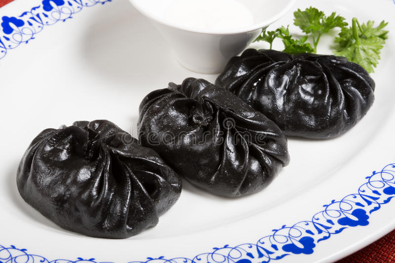 Exotic black momos royalty free stock images