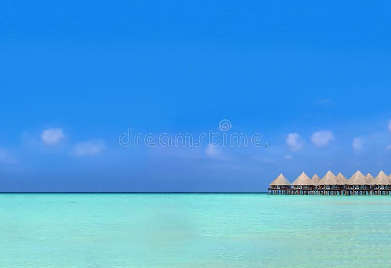 Exotic bungalow at green lagoon. Beautiful tropical blue green lagoon with dreamed bungalow above the clear and clean water stock photos