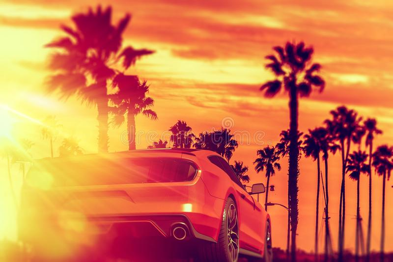 Exotic Car Palm Beach Ride. Exotic Car California Sunset Boulvard Ride. Red Sporty Exotic Car on the Road To the Beach Summer Car Drive stock photography