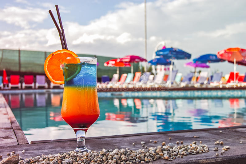 Exotic cocktails on the swimming pool stock images