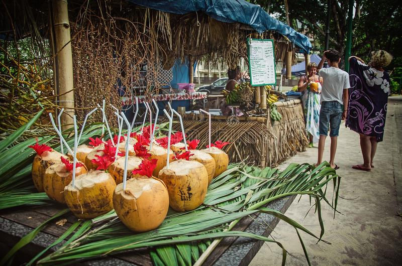 Exotic coctails made of fresh coconuts and the tourists stock photos