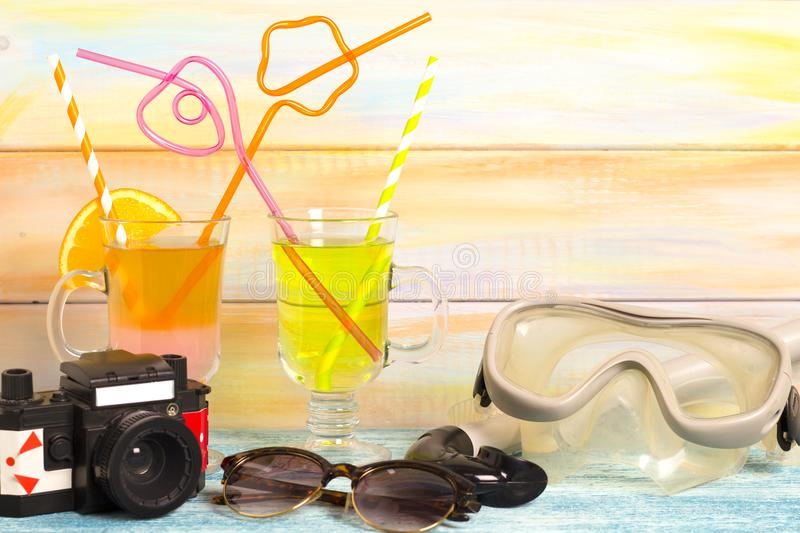 Exotic drinks, camera and diving mask royalty free stock photography