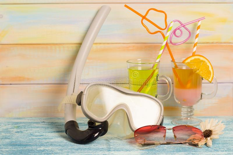 Exotic drinks and diving mask stock images
