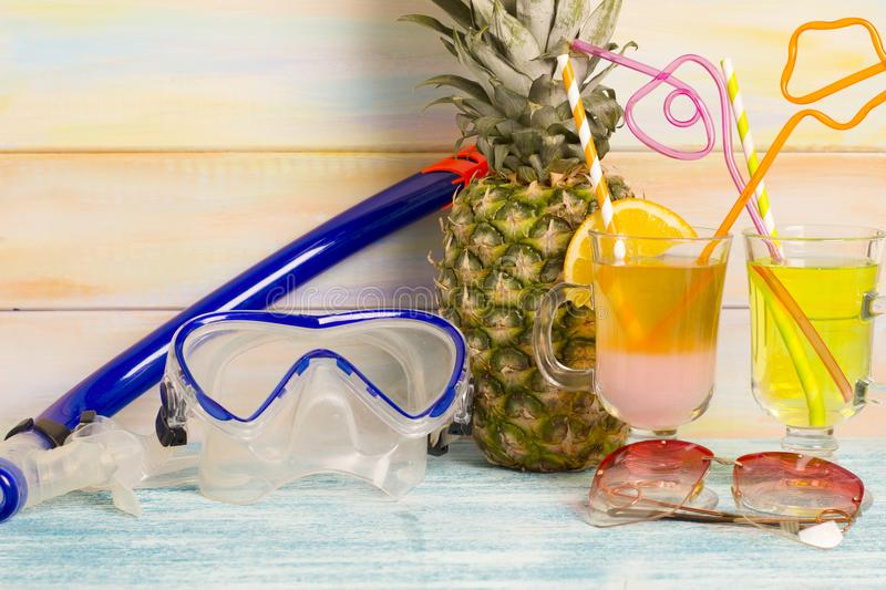 Exotic drinks, pineapple and diving mask royalty free stock photography
