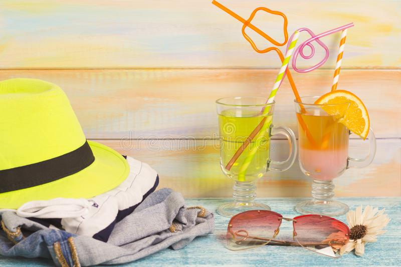 Exotic drinks with traveler's outfit royalty free stock photo