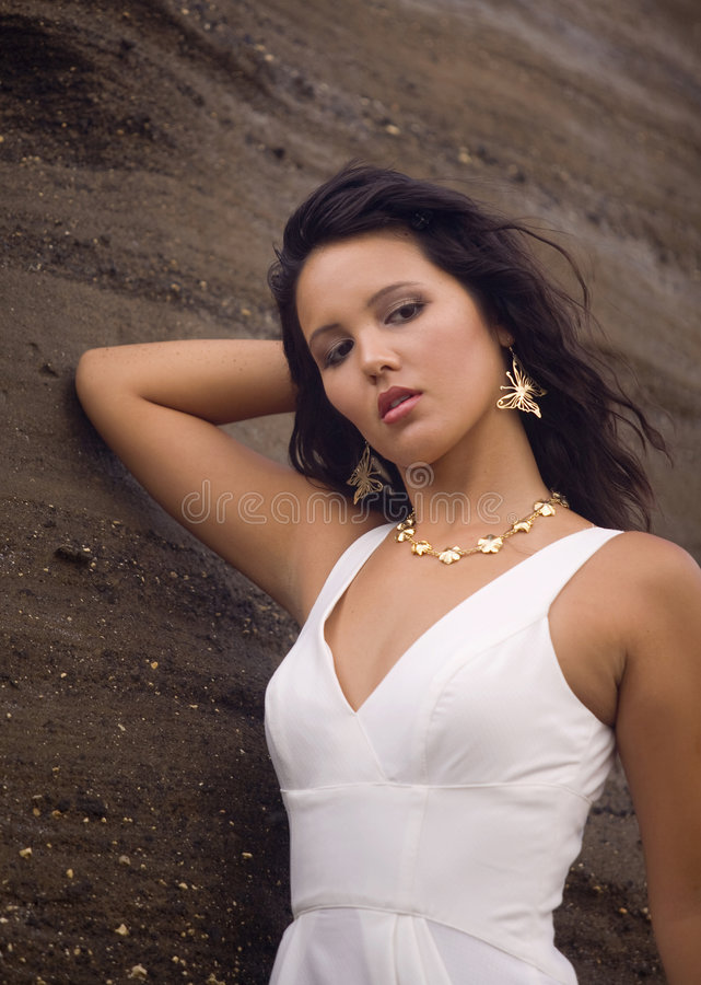 Exotic eurasian woman by sandstone stock photography
