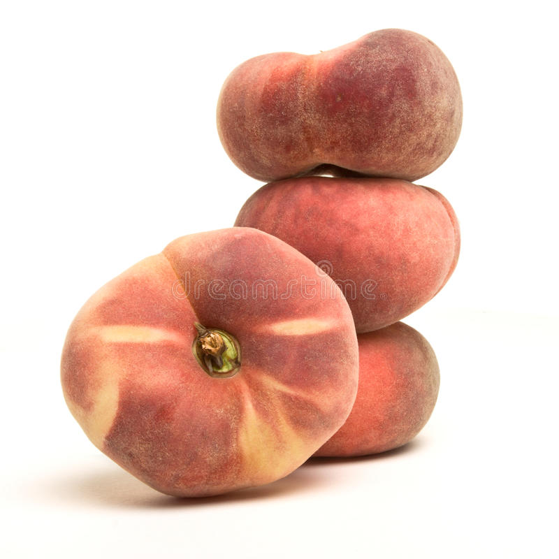 Exotic Flat peach. Also known as donut, chinese or saturn peach royalty free stock images