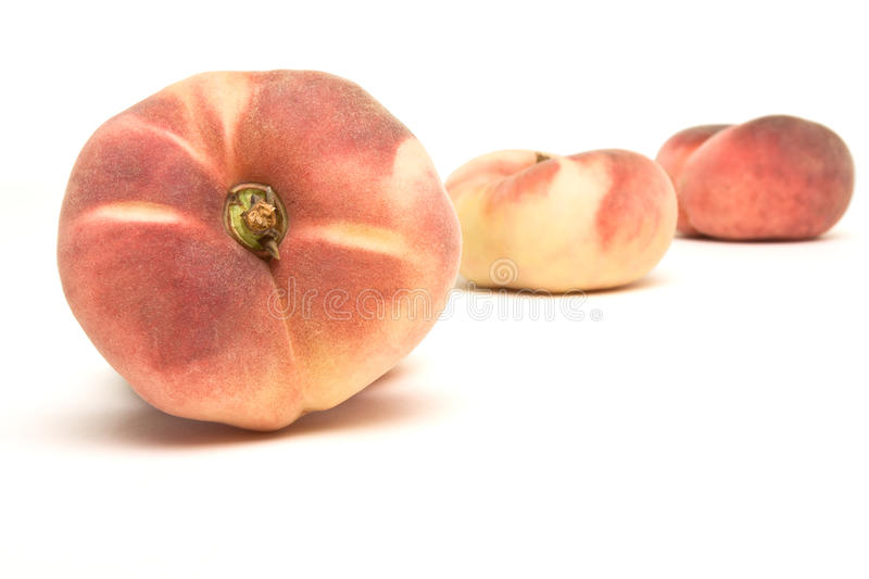 Exotic Flat peach. Also known as donut, chinese or saturn peach stock photos