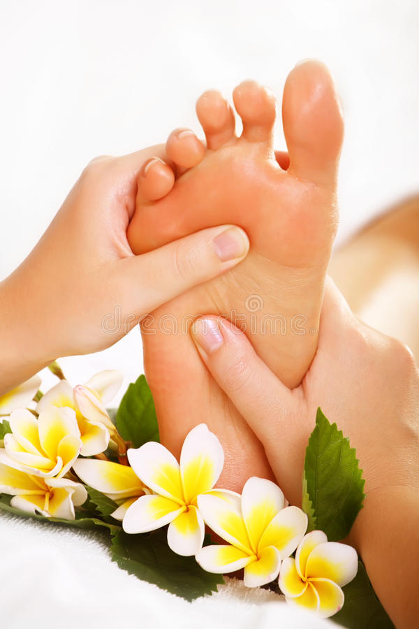 Exotic foot massage stock photography