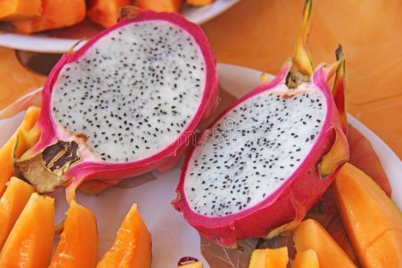 The exotic fruit of the dragon`s eyes. Pink dragon eye and white flesh royalty free stock image