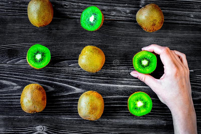 Exotic fruit pattern with sliced kiwi on dark table background t stock photo