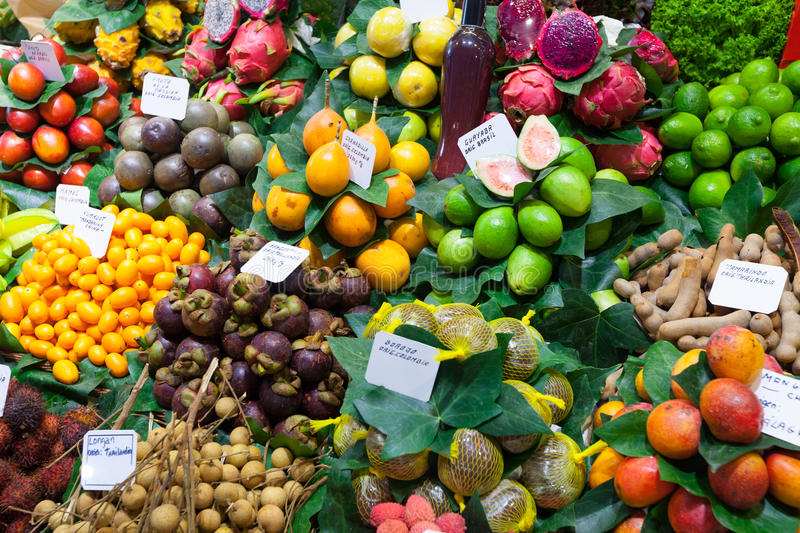 Exotic fruits and berries at Spanish market stock photography
