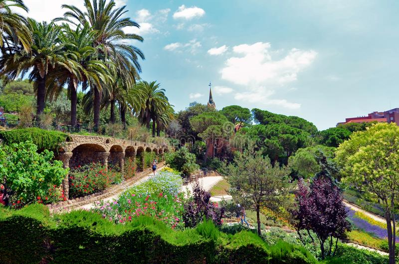 Exotic gardens and palms in Park Guell ,Spain. BARCELONA,SPAIN-10.06.15 : is a public park system composed of gardens and architectonic elements located on royalty free stock images