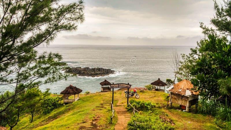 Exotic Hill in Menganti Beach, Kebumen, Central Java, Indonesia. Nature, travel, water, blue, sea, sky, landscape, outdoor, beautiful, ocean, horizon, wave stock images