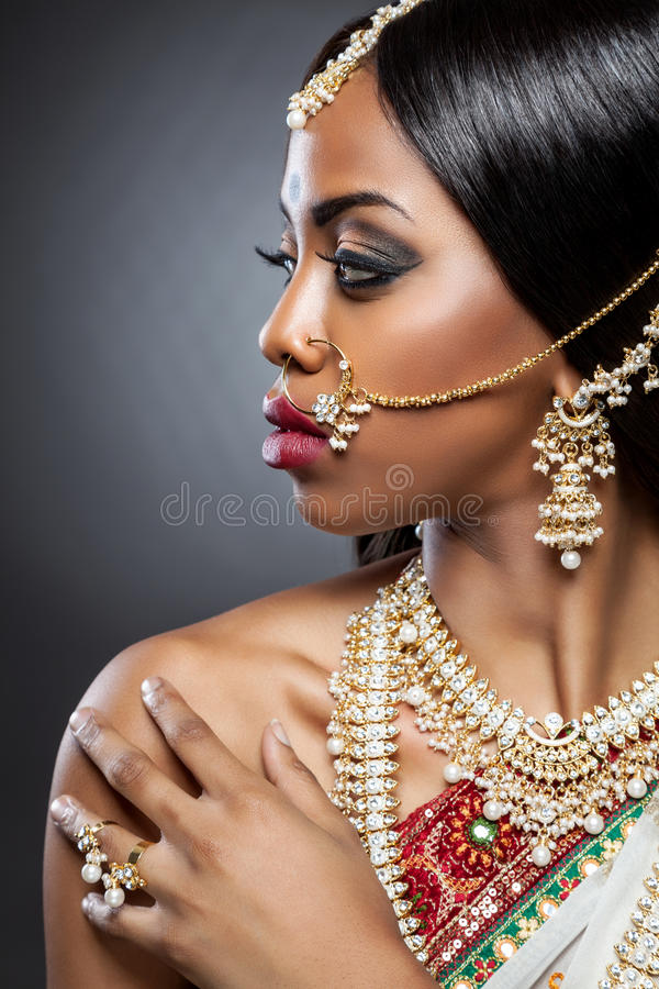 Exotic Indian bride dressed up for wedding stock photography