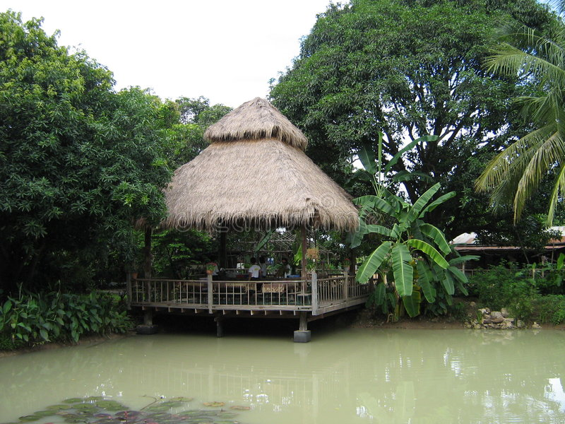 Exotic jungle hut royalty free stock images