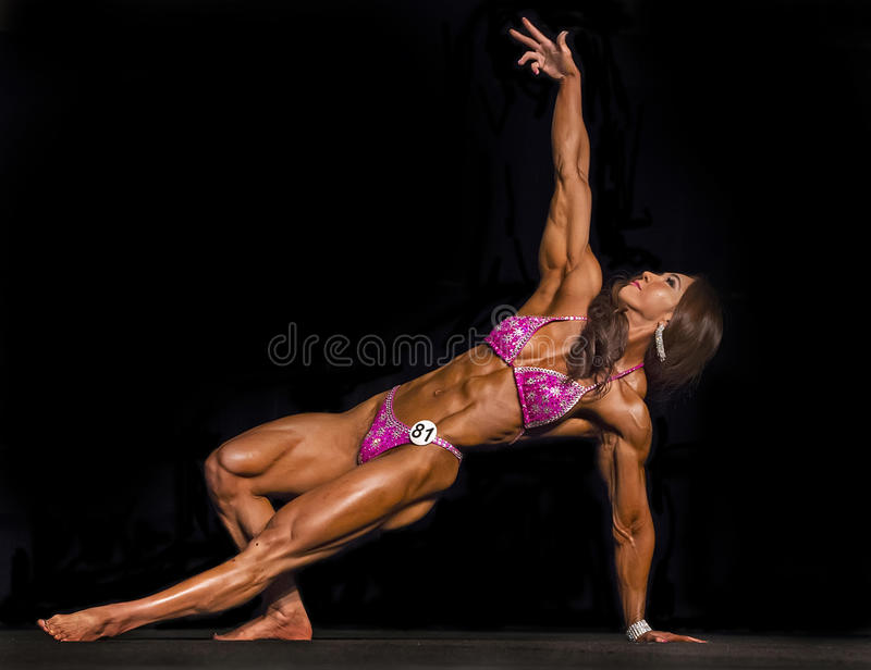 Exotic Korean Physique Athlete Competes in Vancouver. Yeon Woo Ji of Korea displays an impressive muscularity, a developed and defined body, in the pro physique royalty free stock photography