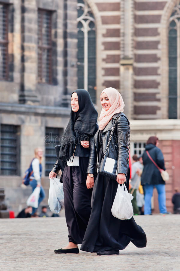 Exotic Muslim girl on the Dam Square, Amsterdam, Netherlands royalty free stock photo