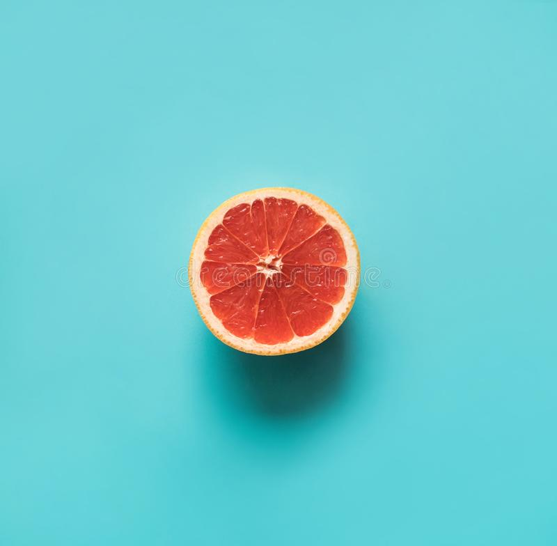 Exotic red orange slice on blue background.Food and drink concept. S ideas royalty free stock photos