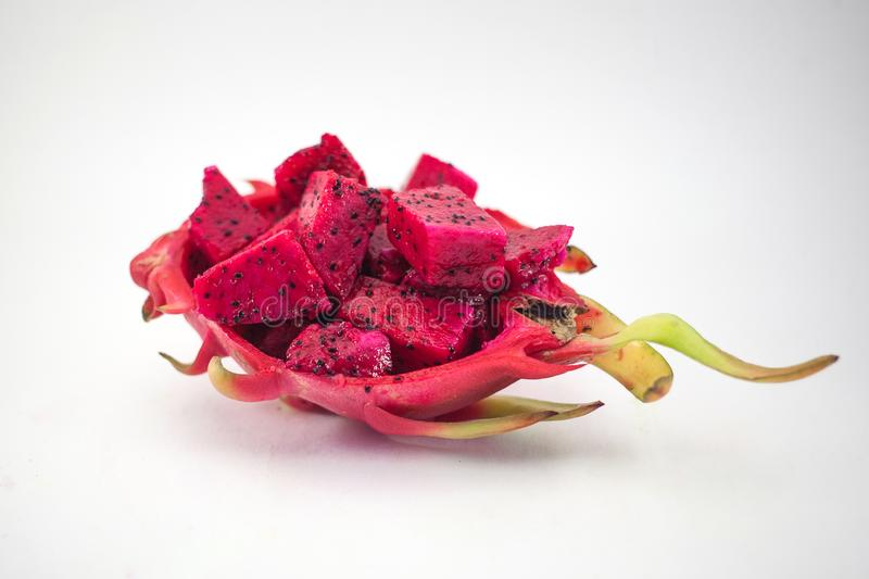 Exotic ripe pink Pitaya or Dragon fruit. Red Pitahaya tropical f. Ruit cut in cubes on white background royalty free stock photo